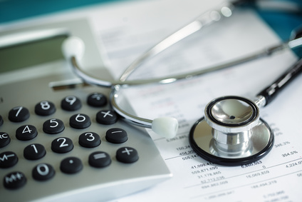Calculator and stethoscope on financial statement for finance health check including breakeven point
