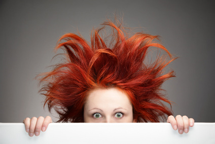 Redhead woman having a bad hair day and looking for help to have her best year ever.