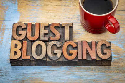 guest blogging - internet concept - text in vintage letterpress wood type stained by color inks with a cup of coffee